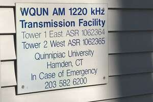A sign on the side of the  former WQUN transmitter building in Hamden.