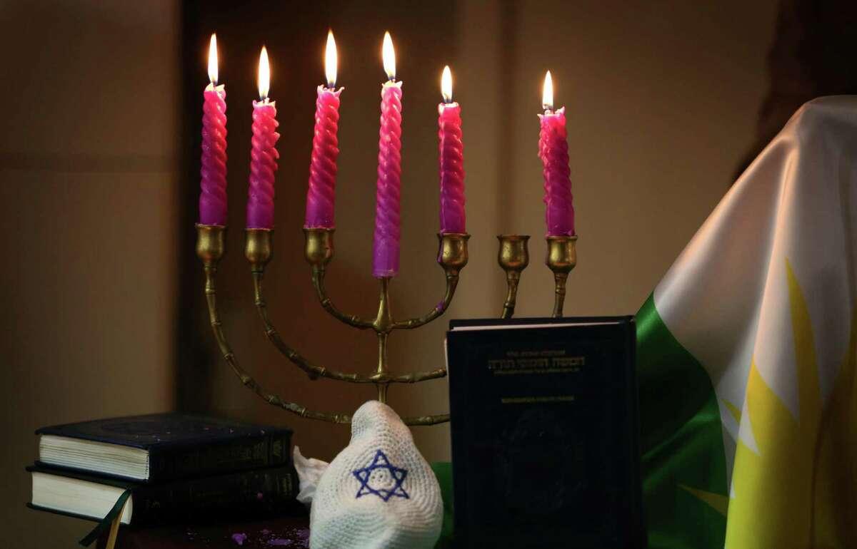 Hanukkah is traditionally represented by a menorah, a seven-branch candelabrum.