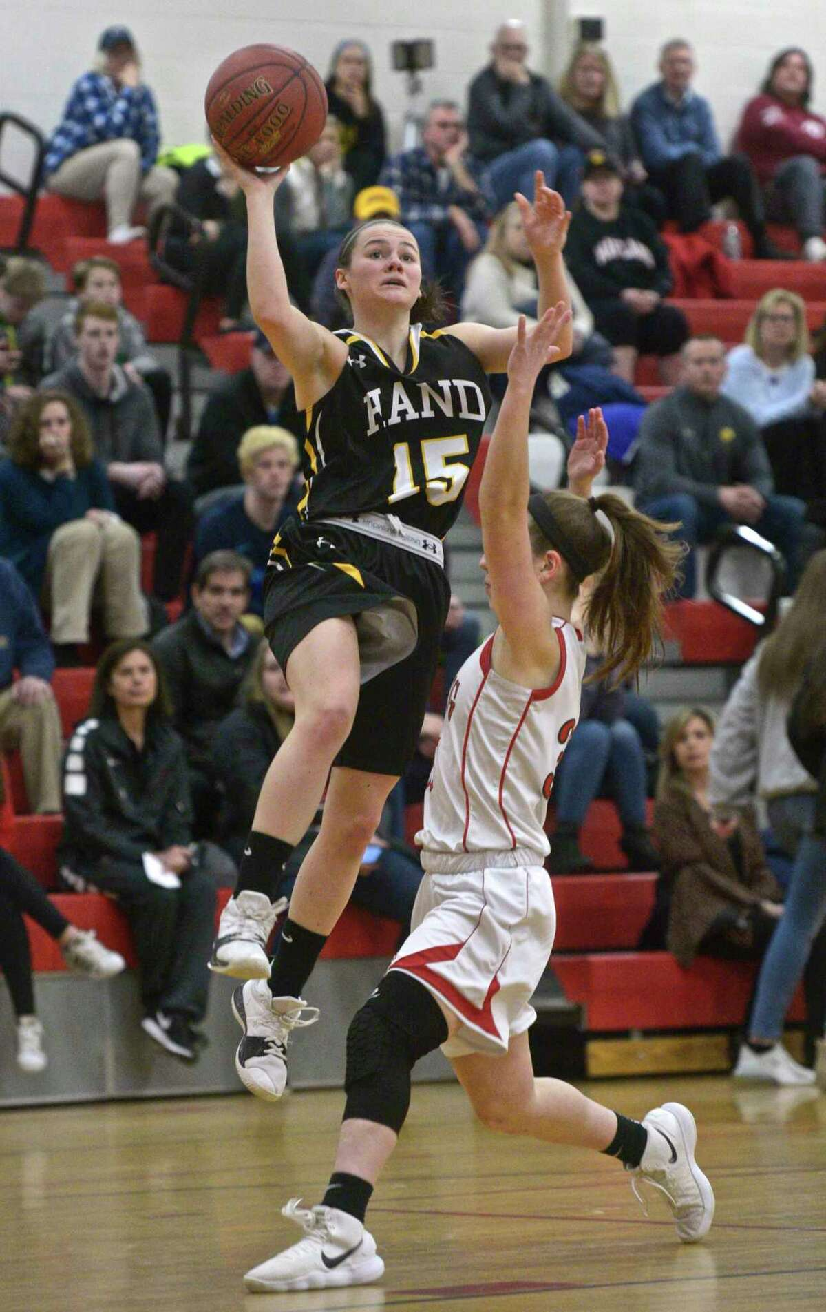 Hand's Sara Wohlgemuth (15) takes a one handed shot over Pomperaug's Madison Villa (35) in the CIAC Class L girls basketball game last season. Wohlgemuth had 45 points in two games during the Appalachia Tournament.