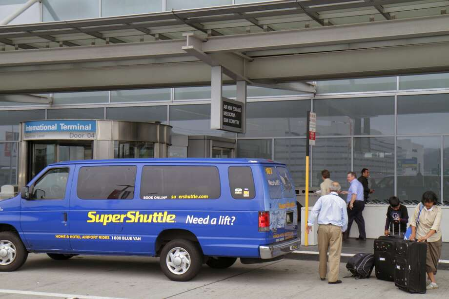FILE - Super Shuttle outside San Francisco International Airport. (Photo by: Jeffrey Greenberg/Universal Images Group via Getty Images) Photo: Jeff Greenberg/Universal Images Group Via Getty