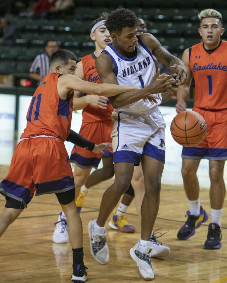 Midland High's Kamden Taylor is fouled as he drives the lane by Eastlake's Jeremy Vasquez 12/12/19 in the Tall City Oilman's Invitational at the Chaparral Center. Tim Fischer/Reporter-Telegram Photo: Tim Fischer/Midland Reporter-Telegram