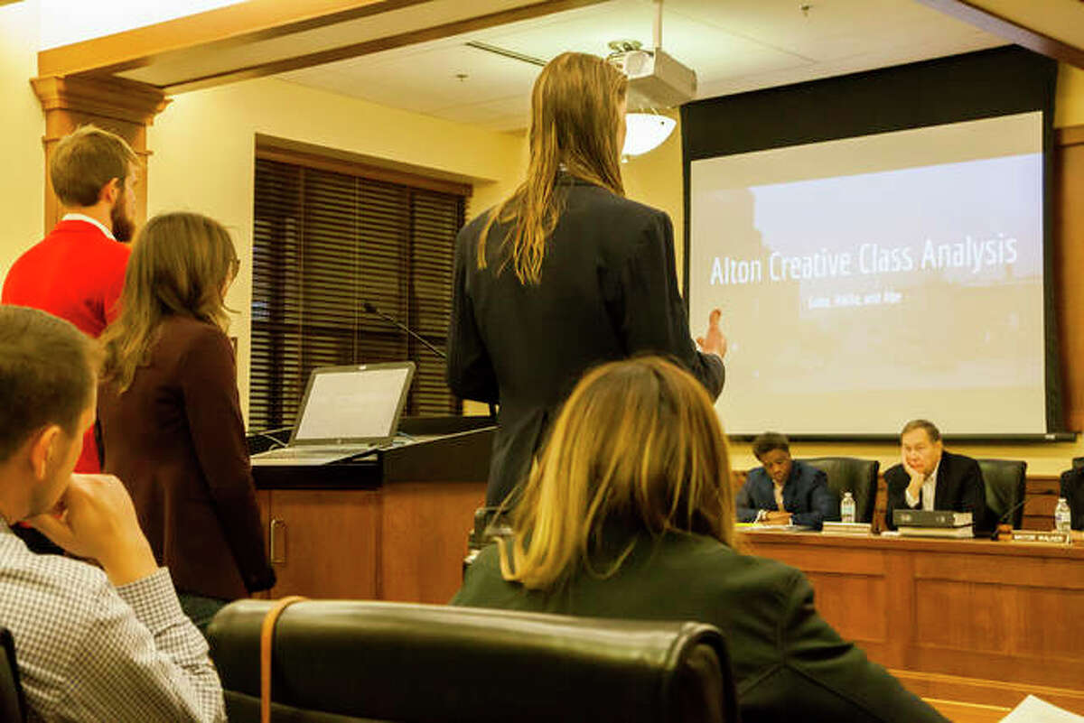 Principia College students Luke McCutcheon, top right, Hallie Jones, top middle, and Abe Ott, top left, address the Alton City Council Wednesday, presenting research on Alton's online image, creative class population and ability to attract a younger demographic.