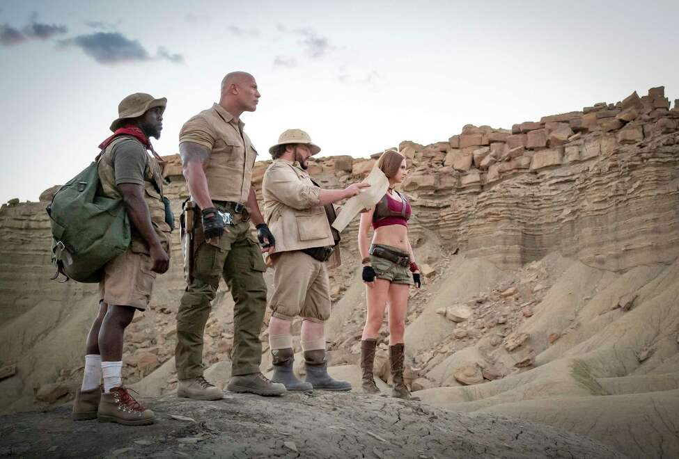 This image released by Sony shows Kevin Hart, from left, Dwayne Johnson, Jack Black and Karen Gillan in a scene from