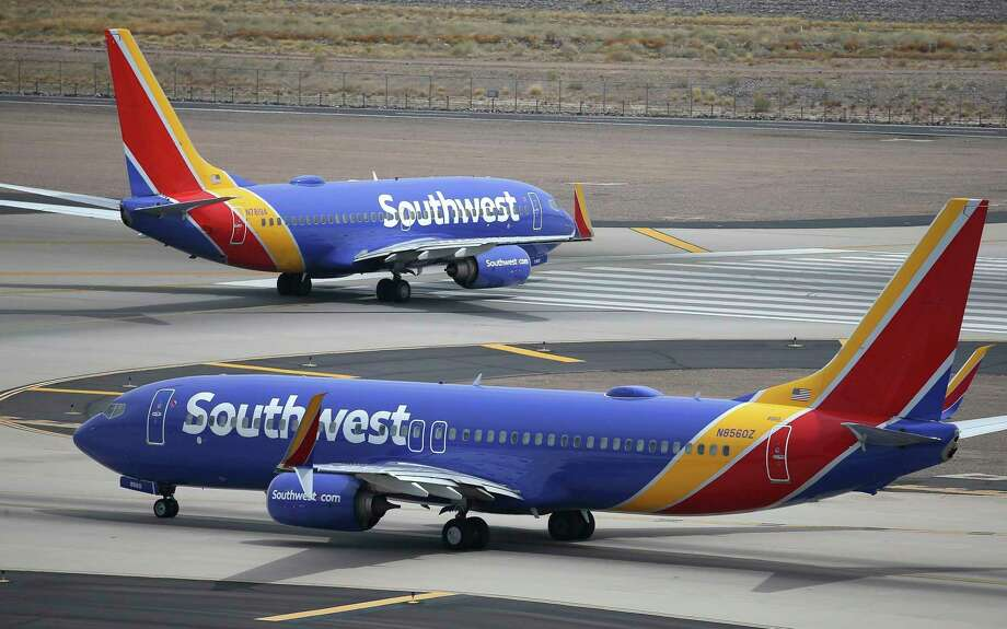 FILE - This July 17, 2019 photo shows Southwest Airlines planes at Phoenix Sky Harbor International Airport in Phoenix. Southwest Airlines Co. reports financial earns on Thursday, Oct. 24. (AP Photo/Ross D. Franklin, File) Photo: Ross D. Franklin, STF / Associated Press / Copyright 2019 The Associated Press. All rights reserved