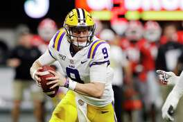 LSU's Joe Burrow looks to pass in the first half against Georgia during the SEC championship game at Mercedes-Benz Stadium in Atlanta on Dec. 7.