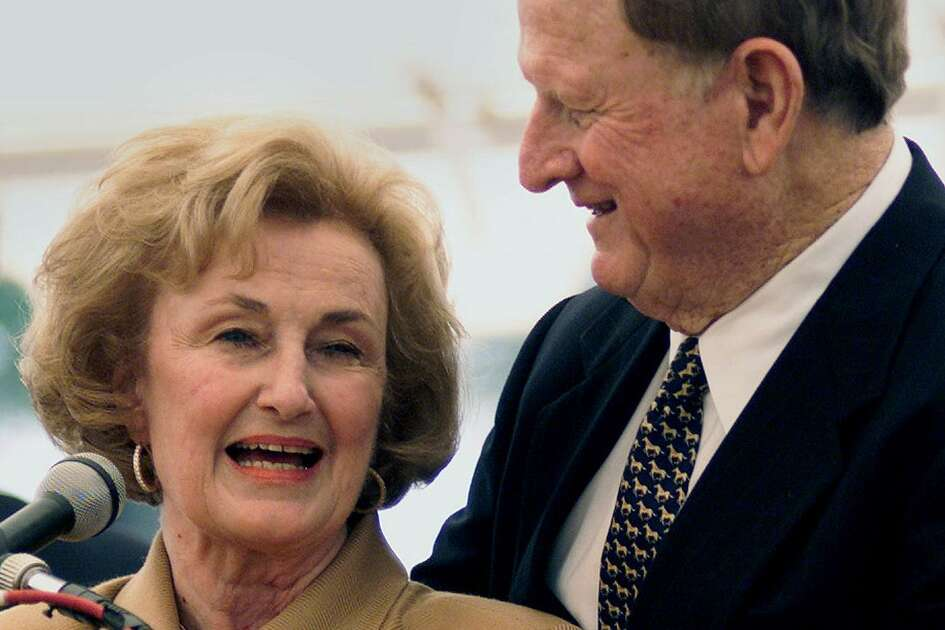 Red McCombs embraces his wife Charline as the two appear at ceremonies marking the dedication of the McCombs School of Business at the University of Texas in Austin on October 26, 2001.