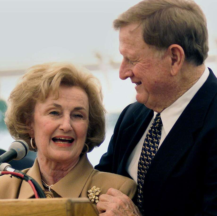 Red McCombs embraces his wife Charline as the two appear at ceremonies marking the dedication of the McCombs School of Business at the University of Texas in Austin on October 26, 2001. Photo: TOM REEL /Staff Photographer