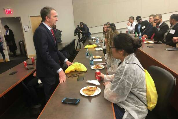 Virginia Gov. Ralph Northam, a Democrat, chats with students at Northern Virginia Community College's Annandale campus on Thursday, Dec. 12, 2019.