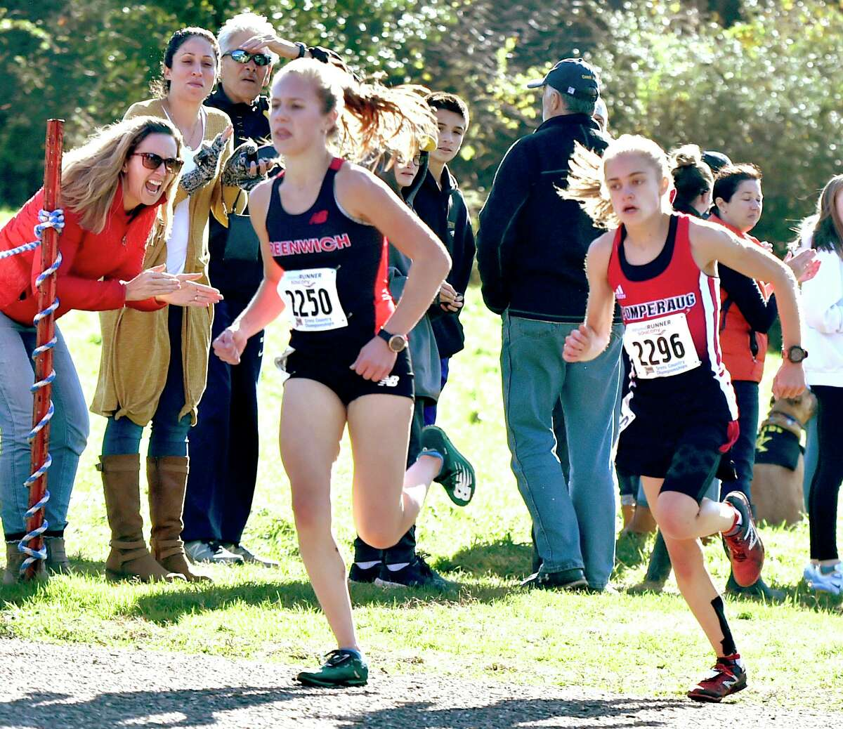 First-place finisher Mari Noble of Greenwich High School, left, and 2nd-place finisher Kate Wiser of Pomperaug race to the finish at the CIAC Girls Cross Country Open at Wickham Park in Manchester on Nov. 1. Wiser is set to race in the Foot Locker Nationals on Saturday in San Diego.