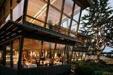 """Canlis, Seattle A family-owned restaurant and architectural icon, Canlis was built by Peter Canlis in 1950. Since then, Canlis has maintained a civilized dining experience for all of its almost seven decades. The dress code remains steadfast: suit or sport coat for the gentlemen, and no shorts, t-shirts, or athletic attire. """"It's about respect for the stranger, respect for the other person in the room,"""" says co-owner Mark Canlis. """"We think that is the foundation of hospitality. The stuff that's happening in the restaurant is sacred. Those moments don't happen again, and to risk it with the guy sitting next to you wearing cutoffs and flip-flops and t-shirts...let's have respect for one another."""" The Canlis salad is one of the restaurant's most beloved dishes, a take on the Caesar salad but with bright lemon, aromatic mint, and crispy bacon lifting it to a new level. It's an anomaly on the menu, which is filled with meticulously modern dishes from chef Brady Williams, where it remains as a nod to the Canlis history (and its legions of fans)."""