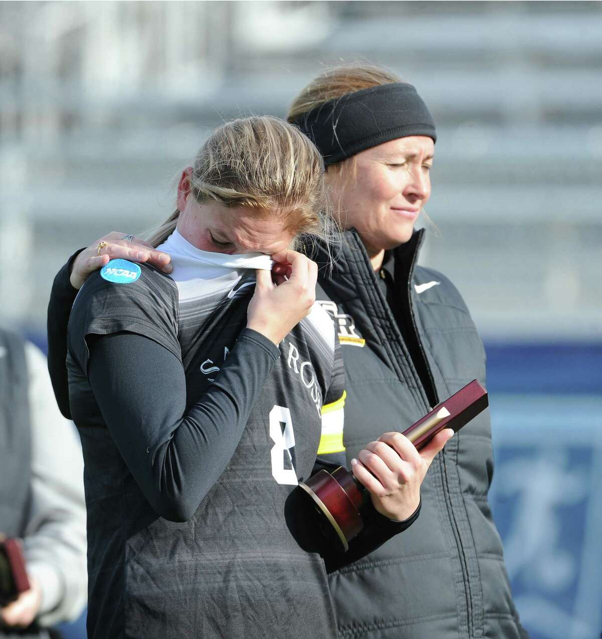 Saint Rose forward Morgan Burchhardt (left) is comforted by head coach Laurie Darling Gutheil after their team fell 3-2 to Grand Valley State in the DII Womena€™s Soccer semi-finals on Thursday, Dec. 12, 2019, at Highmark Stadium in Pittsburgh, Pa. (Philip Pavely/ Special to the Times Union)
