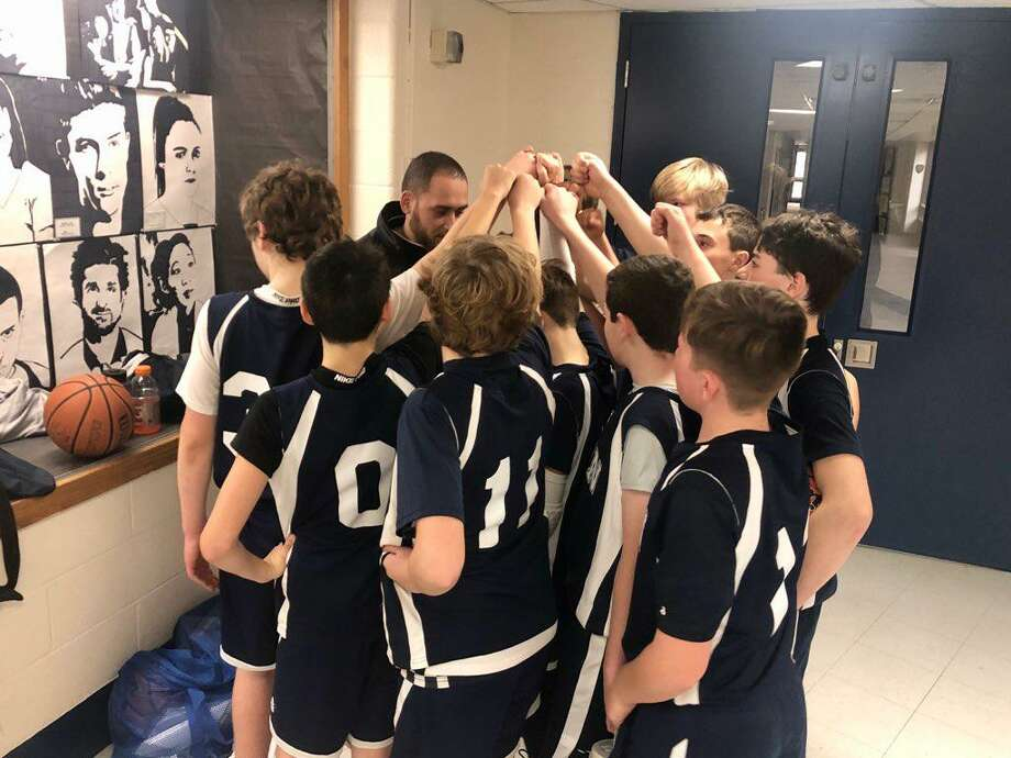 The Wilton boys seventh grade team gathers before one of its games last weekend. Photo: Contributed Photo / Wilton Basketball Association