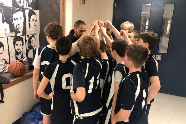 The Wilton boys seventh grade team gathers before one of its games last weekend.