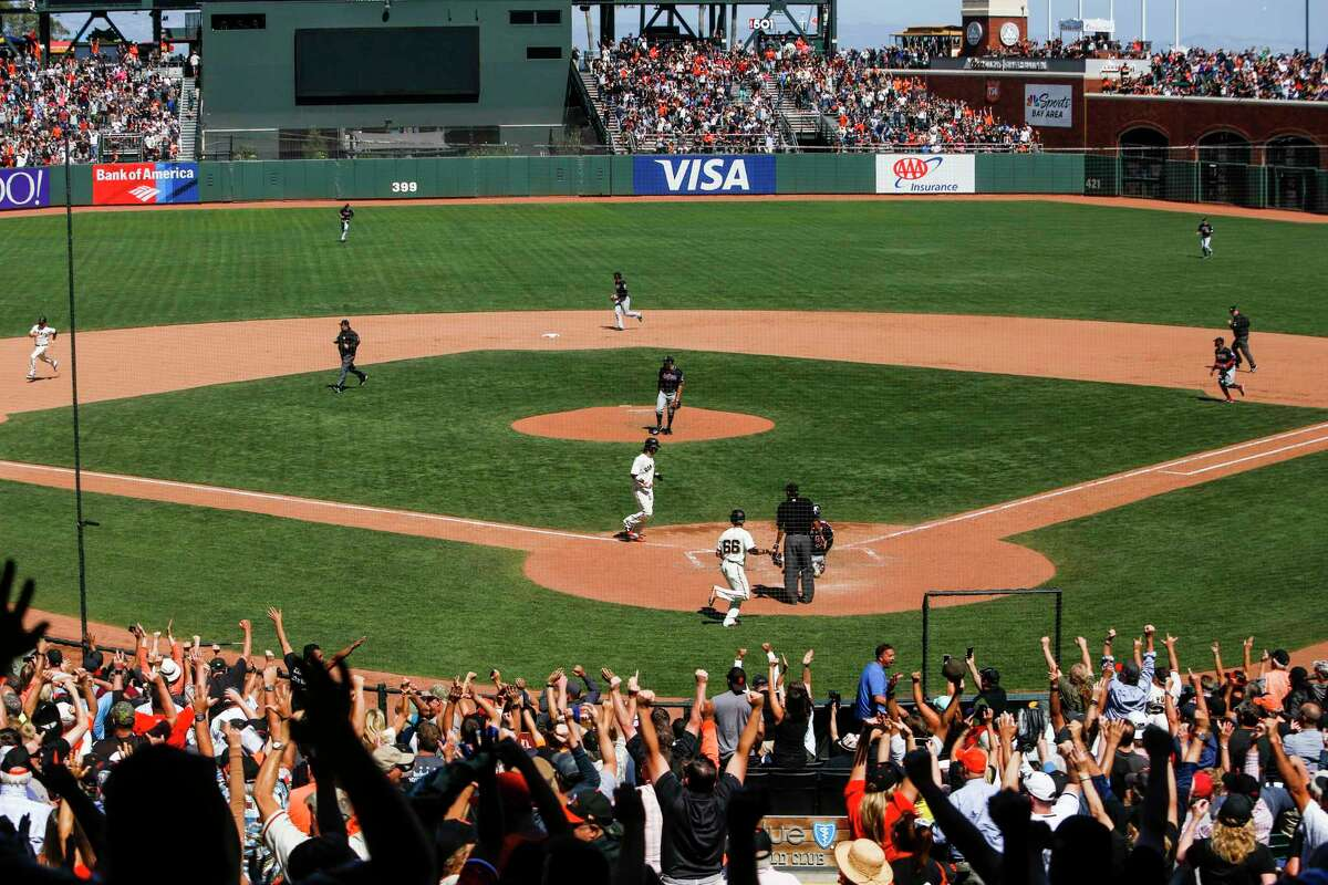 Fan cheer on San Francisco Giants outfielder Gorkys Hernandez (66) as he scores a run during the game against the Cleveland Indians at AT&T Park in San Francisco on Wednesday, July, 19, 2017. The Giants went on to win 5 to 4 in the 9th inning.