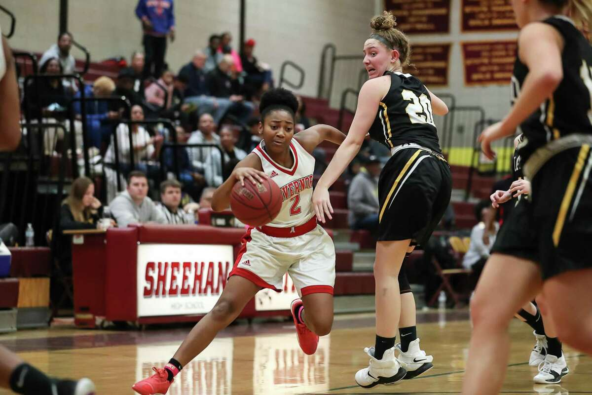 April Artis (2) of Wilbur Cross makes a move around Hand's Summer Adams (20) during a game between Daniel Hand Tigers Girls Varsity Basketball and Wilbur Cross Lady Governors Girls Varsity Basketball on February 16, 2019 at Mark T. Sheehan High School in Wallingford, CT.