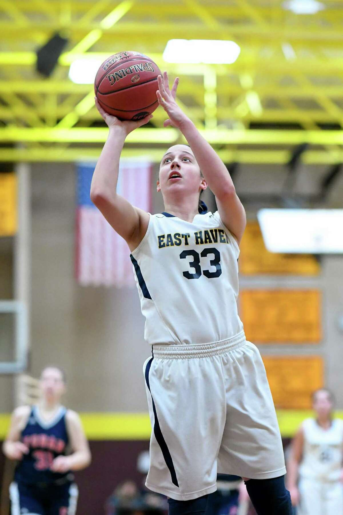 East Haven sophomore center Taylor Salato goes up for a shot on Saturday against Foran in the SCC girls basketball tournament quarterfinals.
