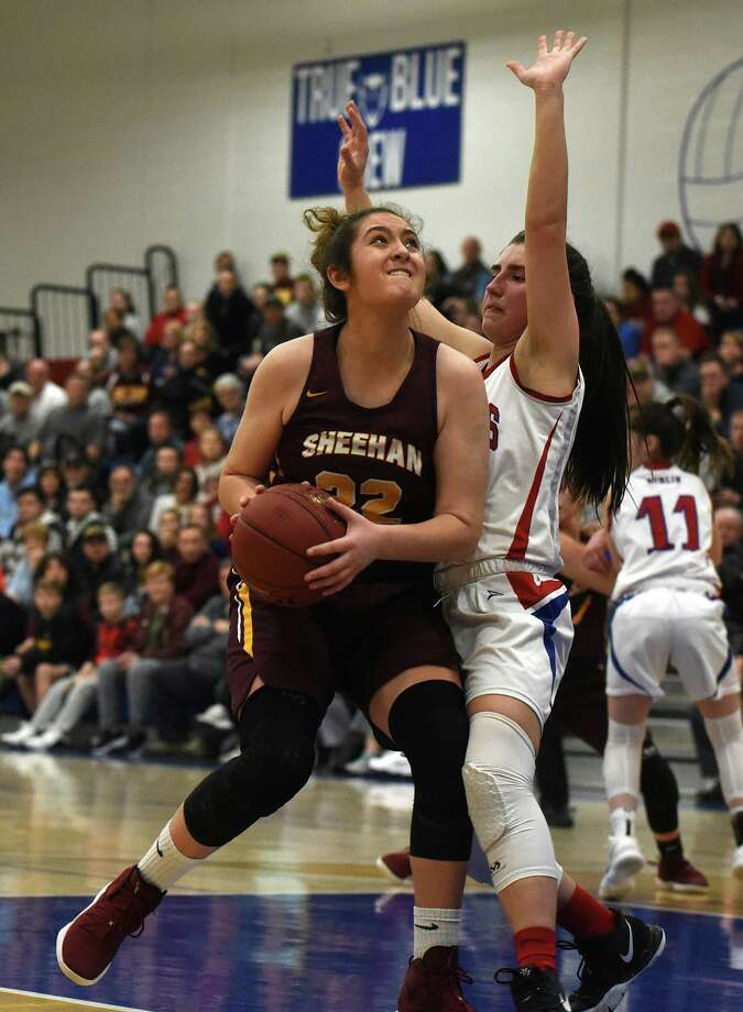 Sheehan's Liv Robles (22) drives to the hoop as Berlin's Lyzi Litwinko (4) defends during the Class M semifinals in Plainville on Monday, March 11. Photo: Dave Stewart / Hearst Connecticut Media