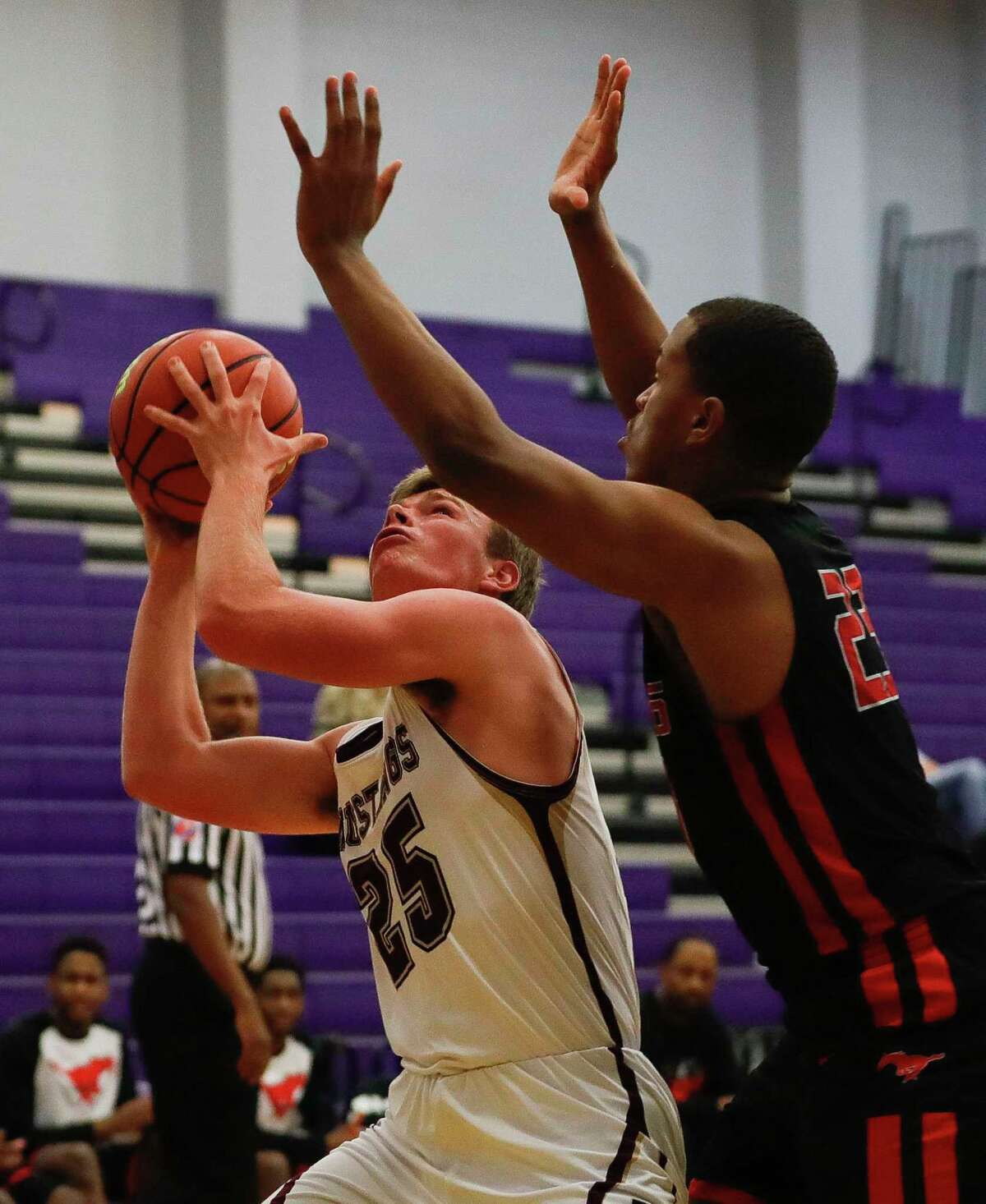 Magnolia West power forward J.P. Ellwanger (25) is pressured by Westfield forward Willie Williams (23) in the first quarter of a high school basketball game at the MHS Bears Holiday Classic, Thursday, Dec. 12, 2019, in Montgomery.