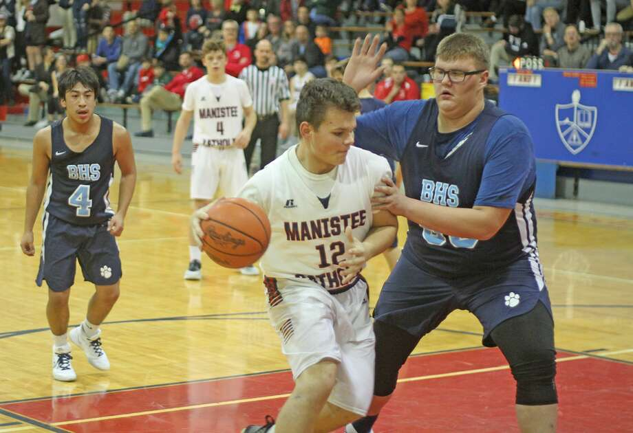 Manistee Catholic Central boys basketball opened its season with a 45-35 win at home over Brethren on Thursday. Photo: Kyle Kotecki/News Advocate