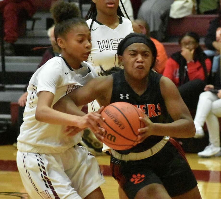 Edwardsville point guard Quierra Love drives hard to the basket in the second quarter.