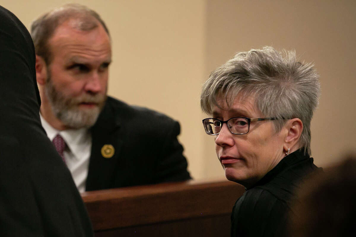 Allison Steele, mother of Cayley Mandadi, looks away as she talks with Prosecutor David Lunan before Visiting Judge Raymond Angelini presiding declared a mistrial in the murder trial of Mark Howerton, who was accused of killing 19-year-old Cayley Mandadi in 2017, in the 144th state District Court of the Cadena-Reeves Criminal Justice Center in San Antonio, Texas, on Dec. 12, 2019.