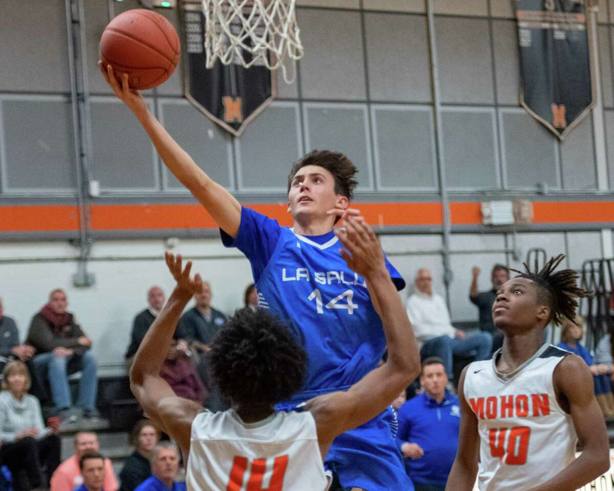 LaSalle senior Anthony Rotello drives to the basket in front of Mohonasen senior Malachi Vice during a Colonial Council game at Mohonasen High School on Thursday, Dec. 12, 2019 (Jim Franco/Special to the Times Union.)
