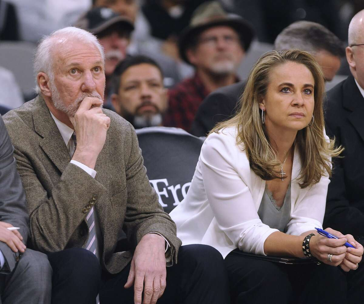 San Antonio Spurs coach Gregg Popovich and assistant Becky Hammon watch as the team falls to the Cleveland Cavaliers in NBA action in the AT&T Center on Thursday, Dec. 12, 2019.