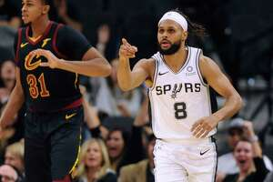 Guard Patty Mills of the San Antonio Spurs gestures after scoring on a three-point shot against the Cleveland Cavaliers during NBA action in the AT&T Center on Thursday, Dec. 12, 2019.