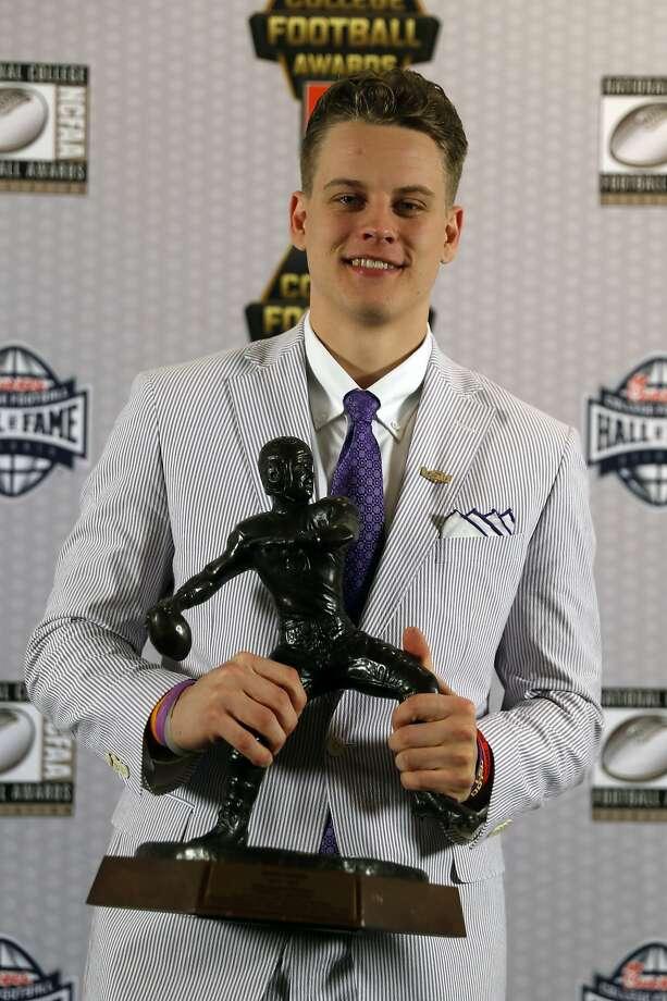 LSU quarterback Joe Burrow poses with trophy after winning the Davey O'Brien Award for being the nation's best quarterback Thursday, Dec. 12, 2019, in Atlanta. (AP Photo/John Bazemore) Photo: John Bazemore, Associated Press