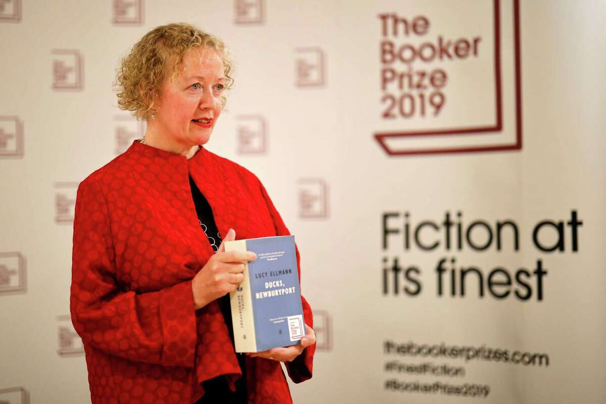US-born British novelist Lucy Ellmann poses with her book 'Ducks, Newburyport' during the photo call for the authors shortlisted for the 2019 Booker Prize for Fiction at Southbank Centre in London on October 13, 2019. (Photo by Tolga Akmen / AFP) (Photo by TOLGA AKMEN/AFP via Getty Images)