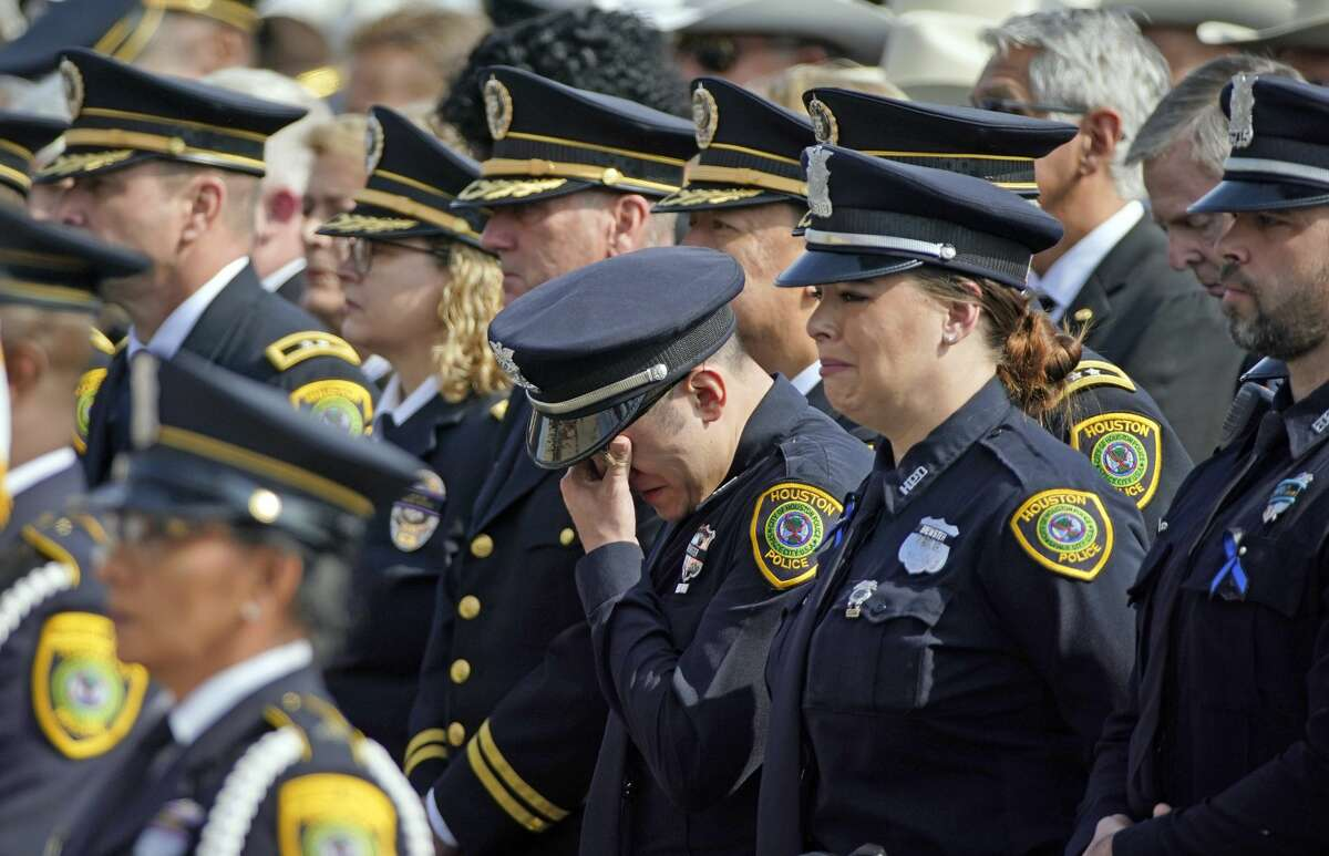 A Houston Police Officer wipes away tears during a funeral service for Houston Police Sgt. Christopher Brewster, Thursday, Dec. 12, 2019, at Grace Church Houston in Houston. Brewster, 32, was gunned down Saturday evening, Dec. 7, while responding to a domestic violence call in Magnolia Park. Police arrested 25-year-old Arturo Solis that night in the shooting death. Solis faces capital murder charges. (AP Photo/David J. Phillip)
