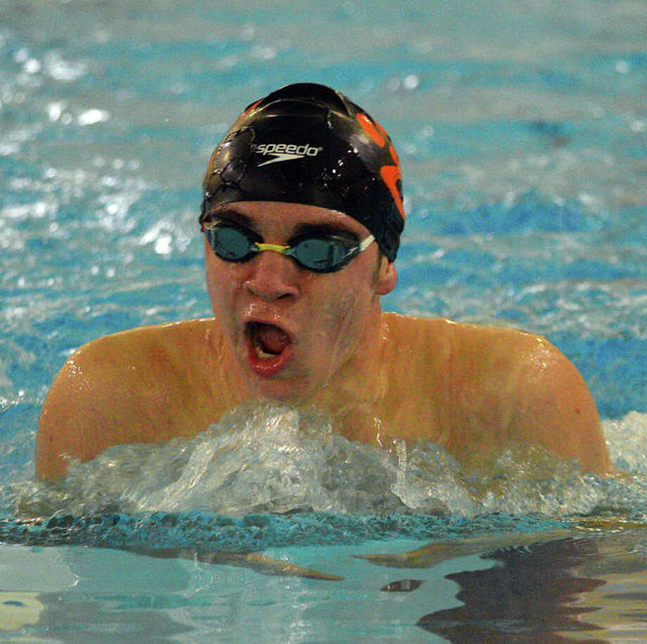 Edwardsville's Canon Adams swims in the 200-yard individual medley during Thursday's dual meet against O'Fallon at Chuck Fruit Aquatic Center. Photo: Scott Marion/The Intelligencer