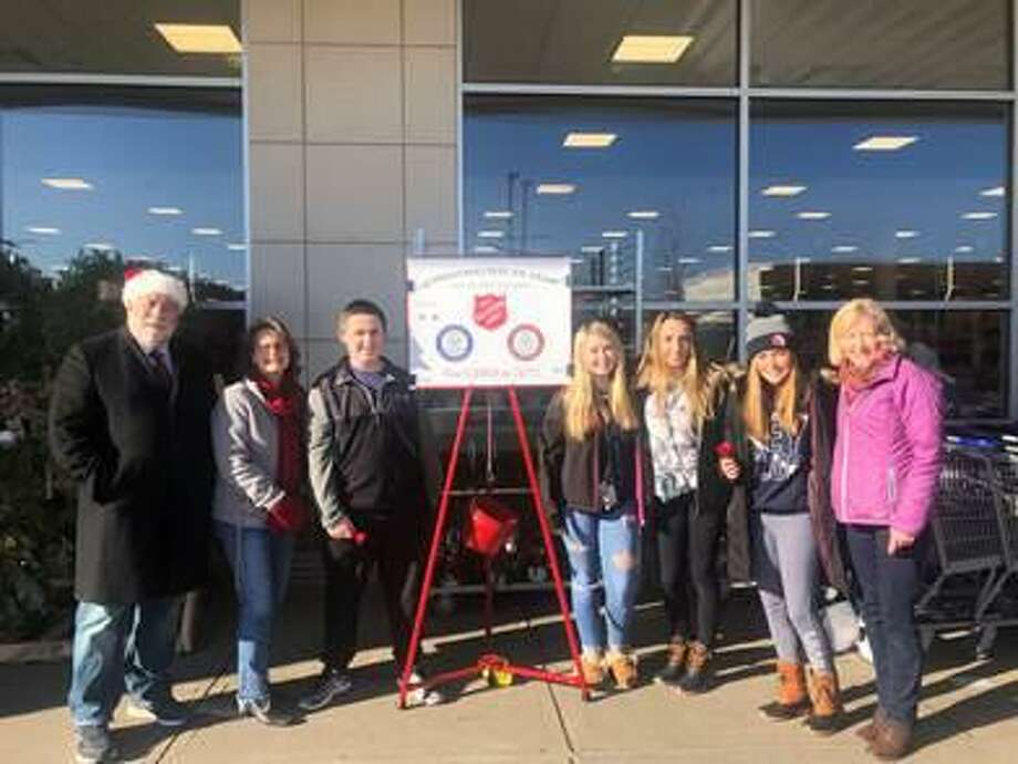 State Reps. Charles Ferraro (R-117) and Kathy Kennedy (R-119) spread some joy in Milford last week ringing the Salvation Army bell and singing some Christmas carols for those in-need with the Key Club students from Foran and Jonathan Law High School. Photo: Contributed Photo