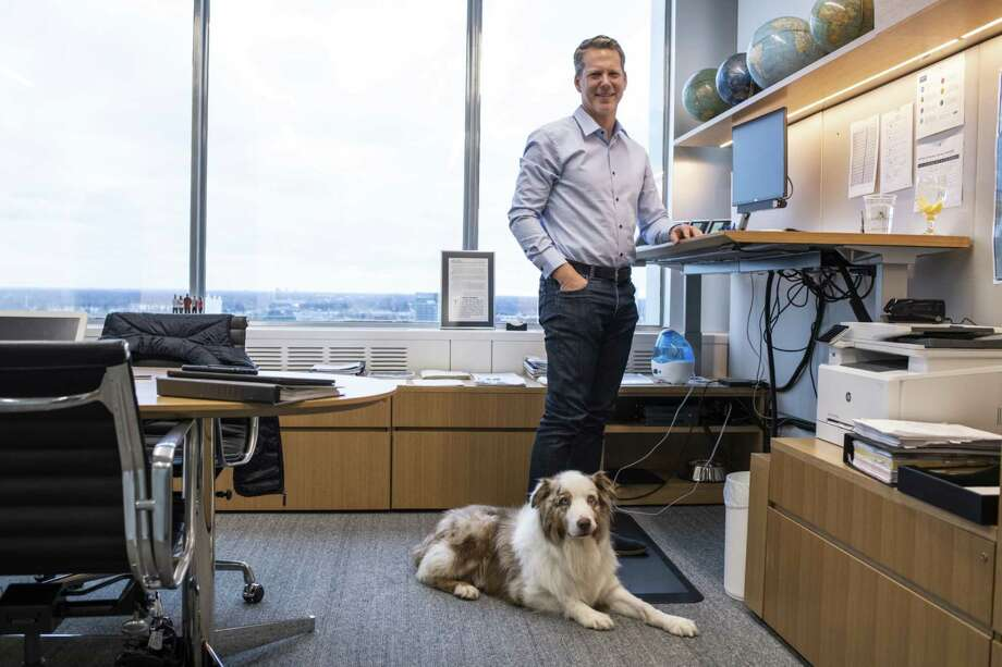 Tim Stone, chief finance officer of Ford Motor Co., and his dog Findley stand for a portrait in Dearborn, Mich., on Dec. 5, 2019. Photo: Bloomberg Photo By Brittany Greeson. / © 2019 Bloomberg Finance LP