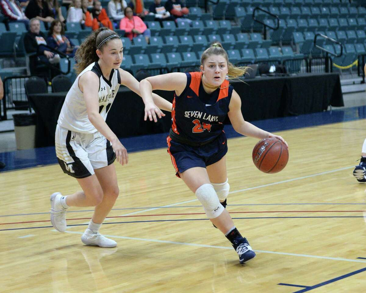 Kennedy Johnston-Nelson (24) of Seven Lakes drives toward the paint during the first half of the third place game in the Katy Classic Basketball Tournament between the Seven Lakes Spartans and the Mansfield Tigers on Saturday, December 7, 2019 at the Leonard Merrell Center in Katy, TX.