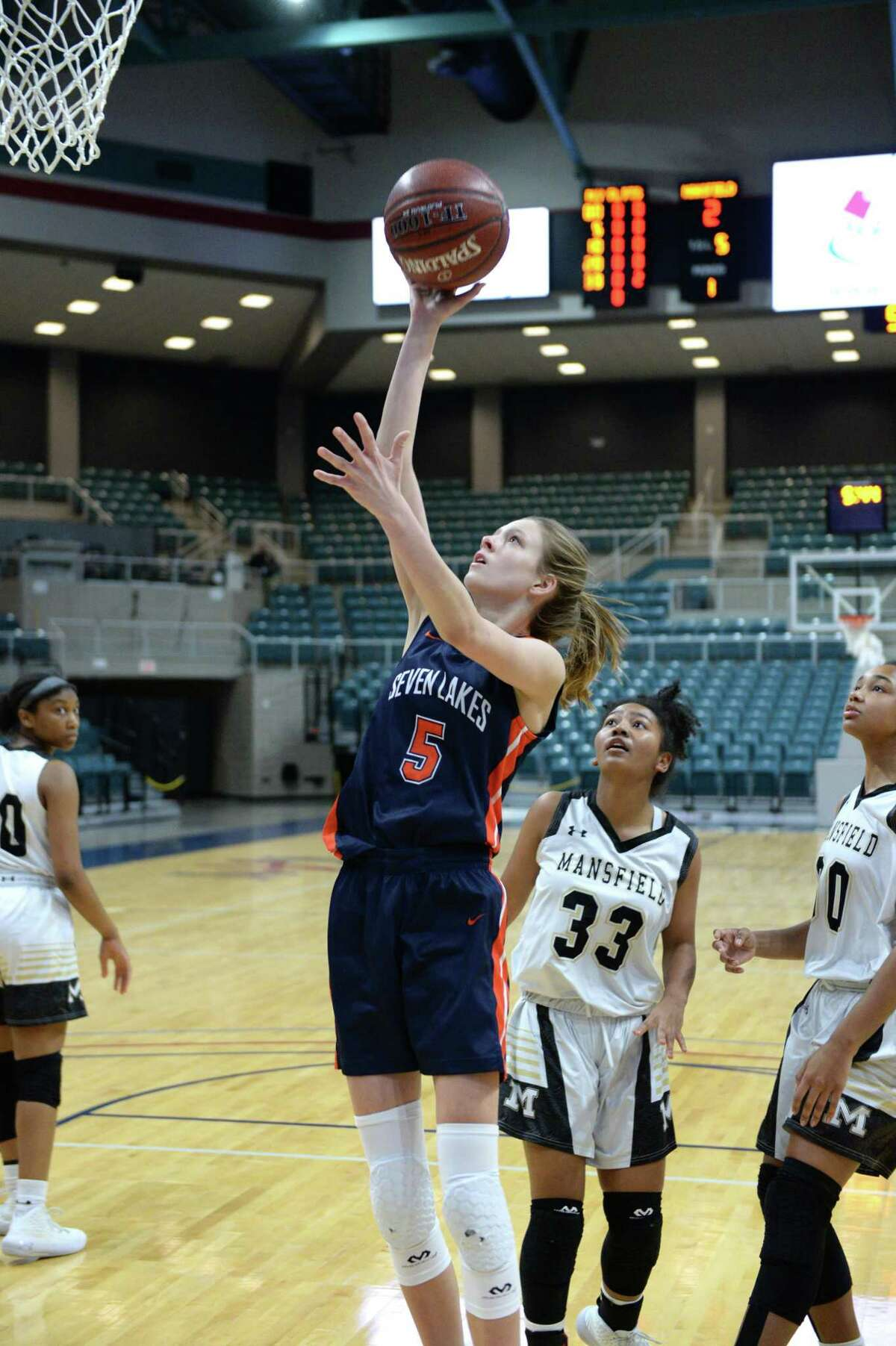 Lily Baumgardner (5) of Seven Lakes floats a shot during the first half of the third place game in the Katy Classic Basketball Tournament between the Seven Lakes Spartans and the Mansfield Tigers on Saturday, December 7, 2019 at the Leonard Merrell Center in Katy, TX.
