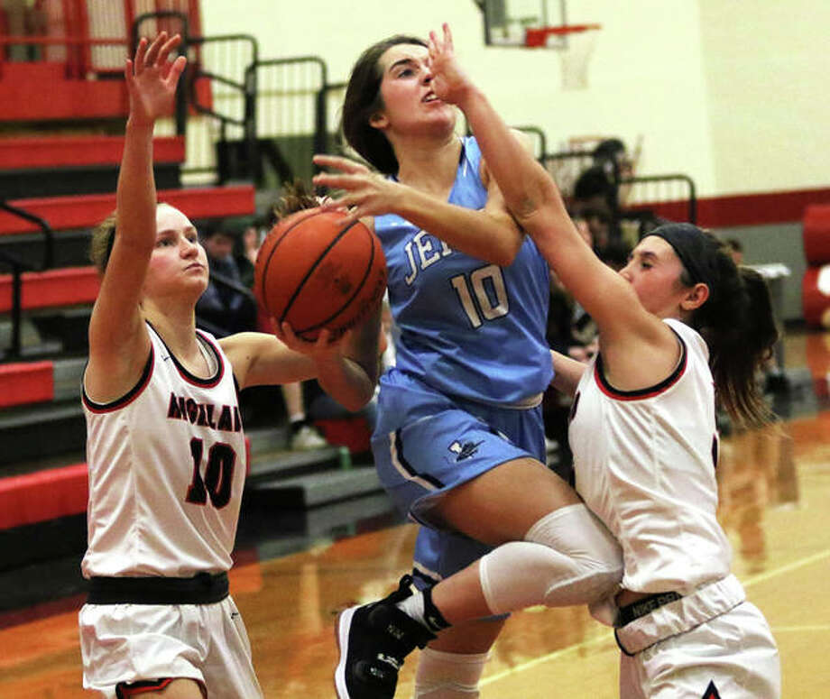Jersey's Abby Manns (middle) puts up a shot between Highland defenders Ellie Brown (right) and Kirsten Taylor in a game Monday at Highland. The Panthers were home at Jerseyville on Thursday and Manns scored 13 points in a win over Marquette Catholic. Photo: Greg Shashack / The Telegraph