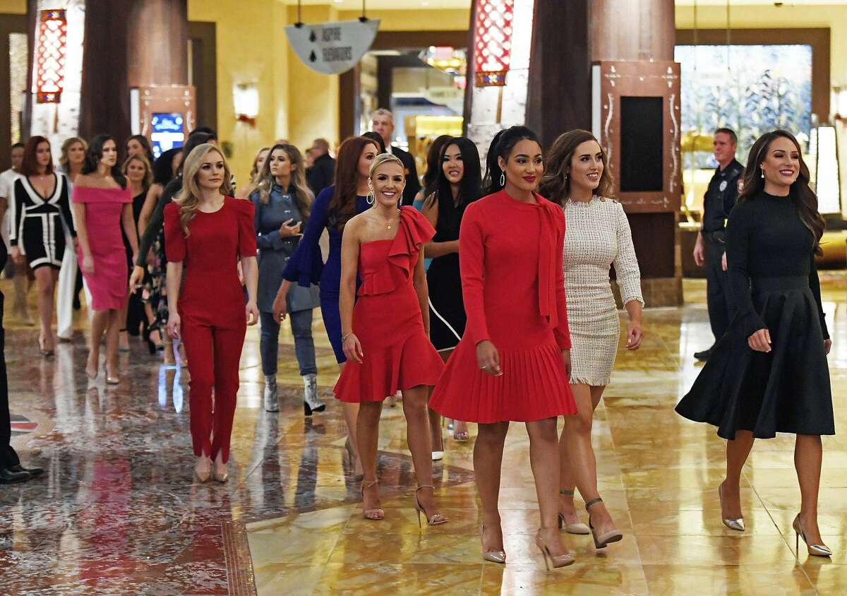The 51 candidates for Miss America 2020 walk through the lobby of the Mohegan Sun hotel as they arrive for the formal Arrival Ceremony for the Miss America 2.0 competition Thursday, Dec. 12, 2019 at Mohegan Sun. The annual competition, in its 99th year, moved from Atlantic to Mohegan Sun this year. The candidates will face a series of preliminary competitions over the coming week culminating in the final competition on live TV next Thursday. (Sean D. Elliot/The Day via AP)