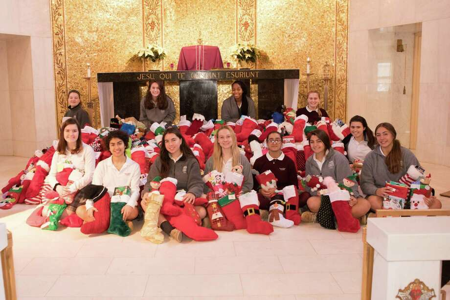 Sacred Heart Academy's Stocking Drive was spearheaded by the Student Council Executive Board and Class Officers. Pictured are Student Council (STUCO) Appointed Member Adalyn Schommer (Cheshire); Senior Class President Shabrang Montazer (Hamden); STUCO President Annie Mackey (Cheshire); STUCO Vice-President Christina Pienkos (North Haven); STUCO Treasurer Mehr Chhatre (Hamden); Sophomore Class President Alexa Guercia (Wallingford); Senior Class President Morgan Dubay (Meriden); Freshman Class President Emilee DeGrand (Hamden); STUCO Appointed Member Anna Weingart (Hamden); STUCO Secretary Clare McCurley (Fairfield); STUCO Appointed Member India Little (New Haven); and STUCO Appointed Member Erin Albright (Milford). Photo: Impressions Studio Of Wallingford