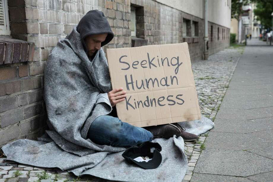 Homeless man soliciting money on the street Photo: Dreamstime / Copyright (C) Andrey Popov