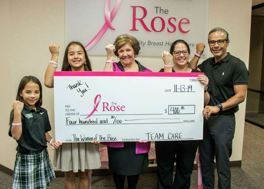 Mia Vasquez, with members of her family and Rose CEO Dorothy Gibbons, recently presented her check to the non-profit breast cancer center.