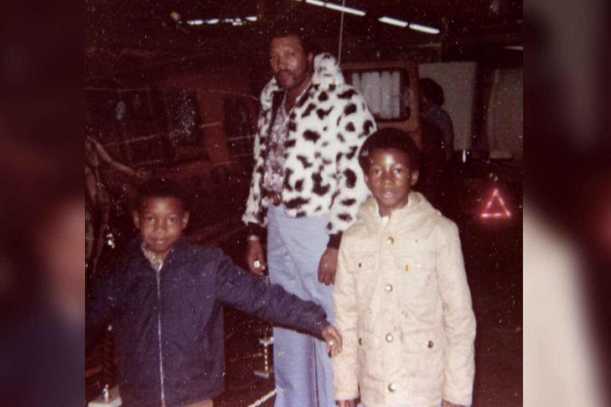 """Earl """"The Pearl"""" Stevens with his sons."""