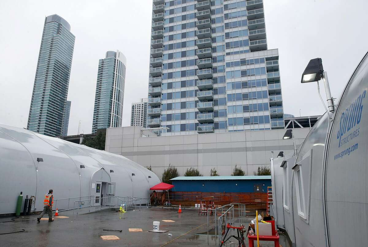 Residential buildings tower above the homeless navigation center which is almost ready to open on The Embarcadero in San Francisco, Calif. on Thursday, Dec. 12, 2019.