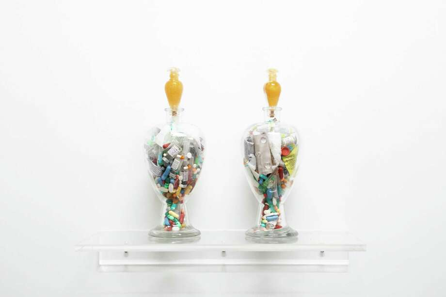 "Francisco Eraso Jr.'s and Alex Dolores Salerno's ""Perfect Lovers,"" glass jars and medical paraphernalia. Photo: Franklin Street Works / Contributed Photo"