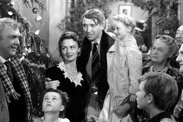 "Donna Reed and James Stewart, center, in a scene from ""It's A Wonderful Life."" Reed's daughter, Mary Owen, is hosting a screening of the holiday favorite at The Ridgefield Playhouse."