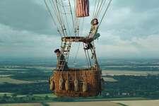 "This image released by Amazon Studios shows Eddie Redmayne, left, and Felicity Jones in ""The Aeronauts."""