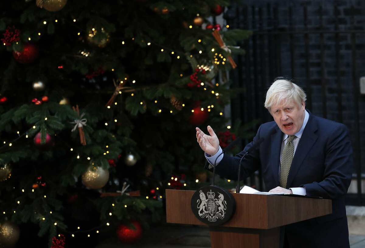 Britain's Prime Minister Boris Johnson addresses the media outside 10 Downing Street in London, Friday, Dec. 13, 2019. Johnson's Conservative Party has won a thumping majority of seats in Britain's Parliament - a decisive outcome to a Brexit-dominated election that should allow Johnson to fulfill his plan to take the U.K. out of the European Union next month.