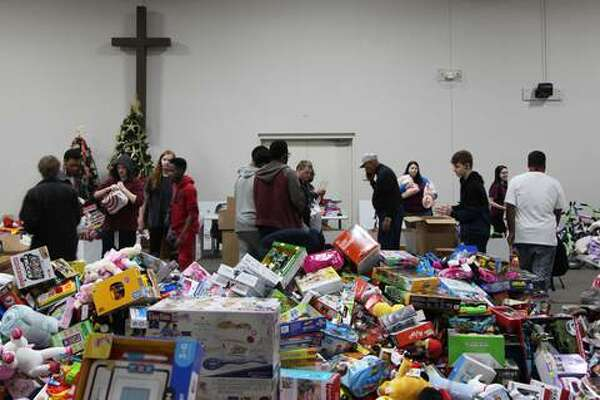 Dozens of United Way volunteers on Thursday collected Community Christmas donation boxes from nearly 60 businesses, churches and schools and sorted items for distribution to 15 local nonprofit agencies.