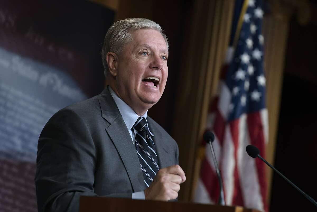 Senate Judiciary Committee Chairman Lindsey Graham, R-S.C., denounces a report by the Justice Department's internal watchdog that concluded the FBI was justified in opening its investigation into ties between the Trump presidential campaign and Russia and did not act with political bias, on Capitol Hill in Washington, Monday, Dec. 9, 2019.