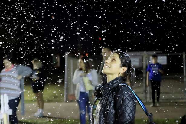 Maria Nance enjoying a moment with artificial snow at the Reindeer Park event in Pearland.